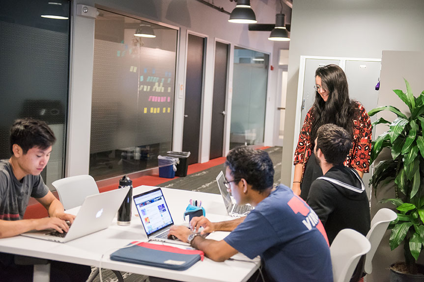 Entrepreneurial UMBC students working together in an office